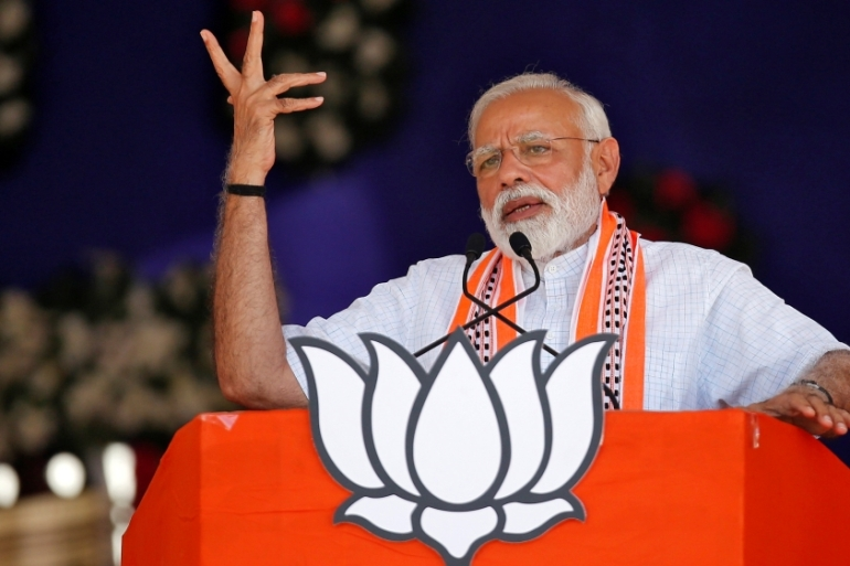 Narendra Modi led his Bharatiya Janata Party to a landslide win on the back of a divisive campaign [Amit Dave/Reuters]