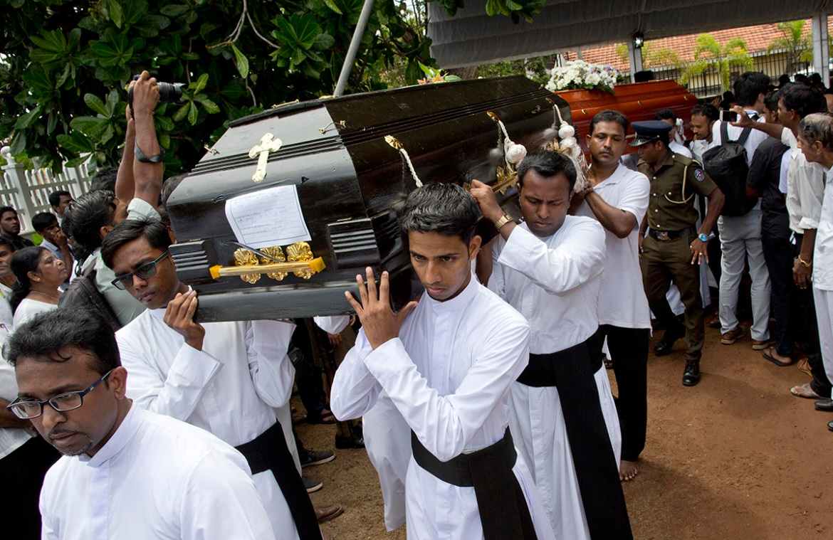 The attacks are the worst ever against Sri Lanka's small Christian minority. The country's deputy defence minister said the initial investigation shows the bombings were in 'retaliation' for shootings at two New Zealand mosques last month. [Gemunu Amarasinghe/AP]