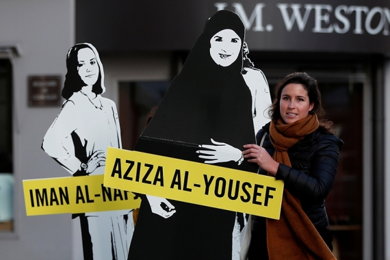Demonstrators from Amnesty International stage a protest on International Women's Day for Saudi women [File: Benoit Tessier/Reuters]