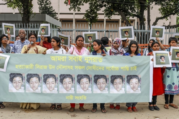 Bangladeshi women hold banners and photographs of schoolgirl Nusrat Jahan Rafi at a protest in Dhaka [AFP]