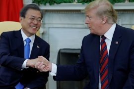 South Korea's President Moon Jae-in shakes hands with US President Donald Trump at the start of a meeting in the Oval Office at the White House in Washington [Carlos Barria/Reuters]