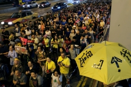 Demonstrators held yellow umbrellas, the symbol of the Occupy Central movement during the protest [Tyrone Siu/Reuters]