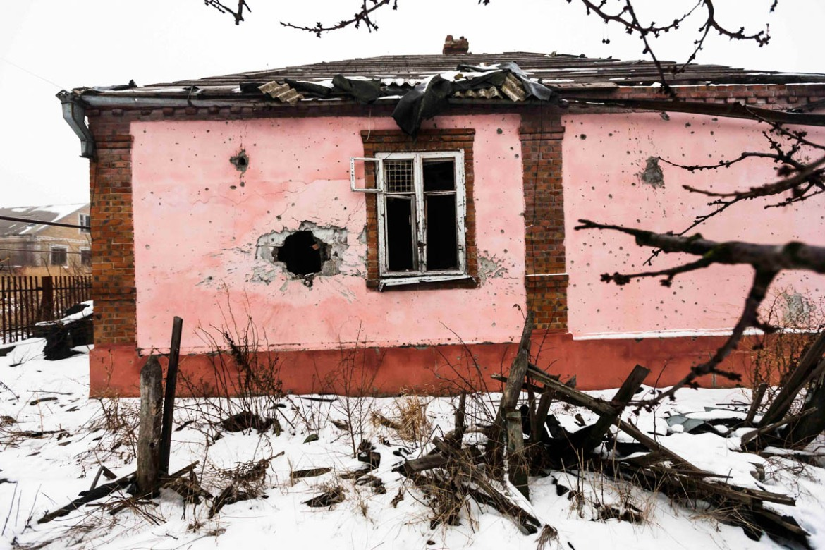 A shelled house after heavy firefights with artillery and big machine guns on the front line in south Ukraine, between Donetsk and Mariupol. [Erik Messori/CAPTA/Al Jazeera]