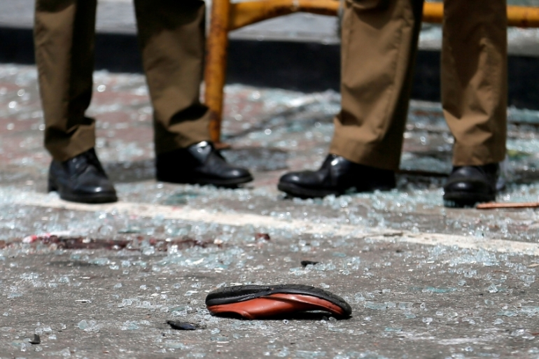 A shoe of a victim is seen in front of St Anthony's Shrine after an explosion in Colombo on Sunday [Dinuka Liyanawatte/Reuters]