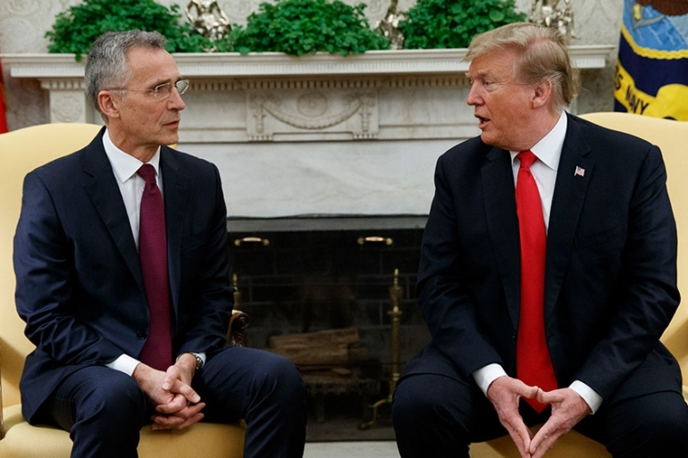 President Donald Trump speaks during a meeting with NATO Secretary General Jens Stoltenberg in the Oval Office of the White House on Tuesday [Evan Vucci/AP Photo]