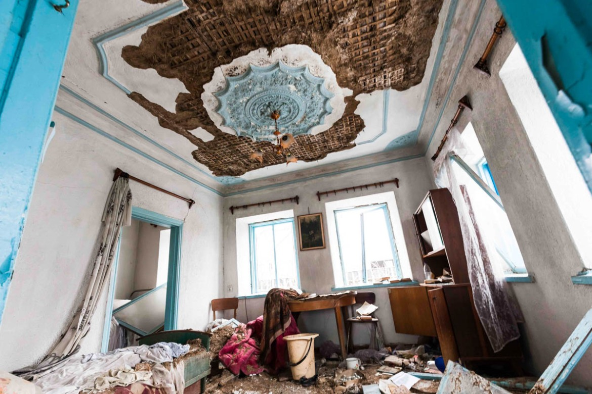 Inside a shelled house after heavy firefights with artillery and heavy machine guns in the village of Shirokino, in Ukrainian territory. [Erik Messori/CAPTA/Al Jazeera]