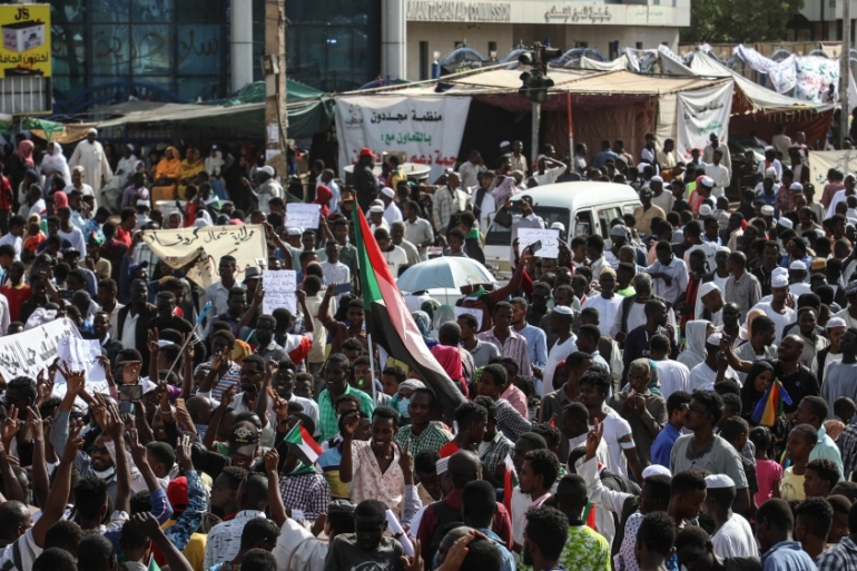 Sudanese demonstrators in front of military headquarters in Khartoum are demanding a civilian transitional government [Mahmoud Hjaj/Anadolu]