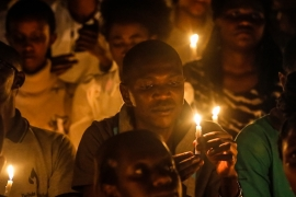 People hold candles during a candle light vigil for those who were killed in the 1994 genocide, during a commemoration event at Amahoro stadium in the capital Kigali, Rwanda, 07 April 2019. EPA-EFE/DAI KUROKAWA [EPA]