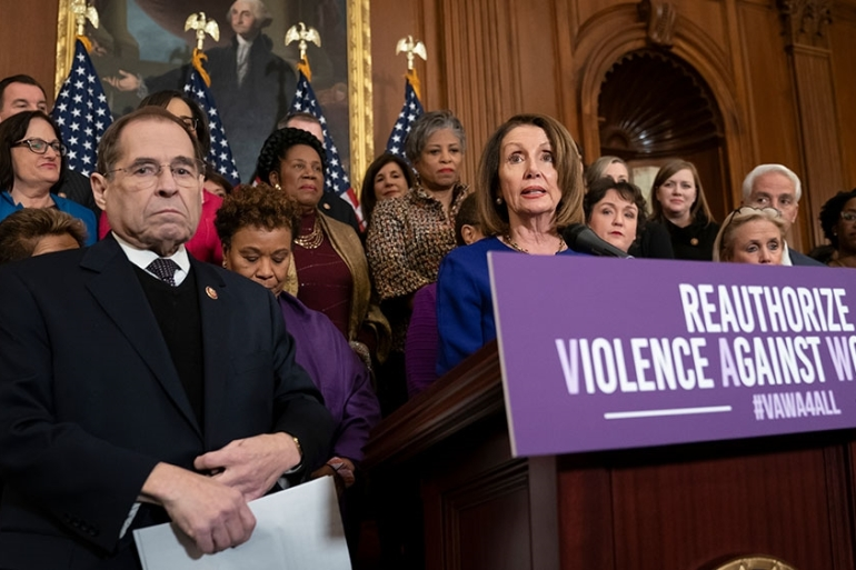 Nancy Pelosi joined at left by House Judiciary Committee Chairman Jerrold Nadler calls attention to Democrat plans to reauthorise the Violence Against Women Act [File: J Scott Applewhite/AP Photo]