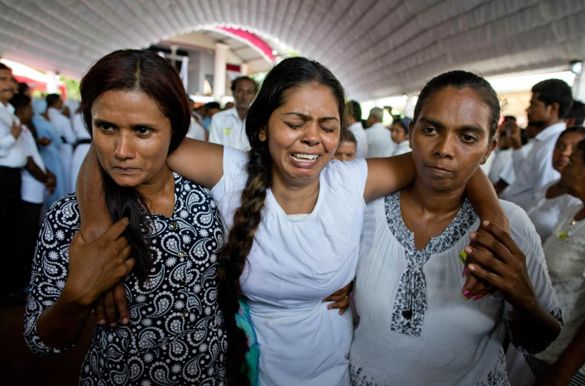 Nearly all victims were Sri Lankan. Dozens of foreigners were also killed. At least 45 children were among the more than 320 dead according to the UN children's agency, UNICEF. [Gemunu Amarasinghe/AP]