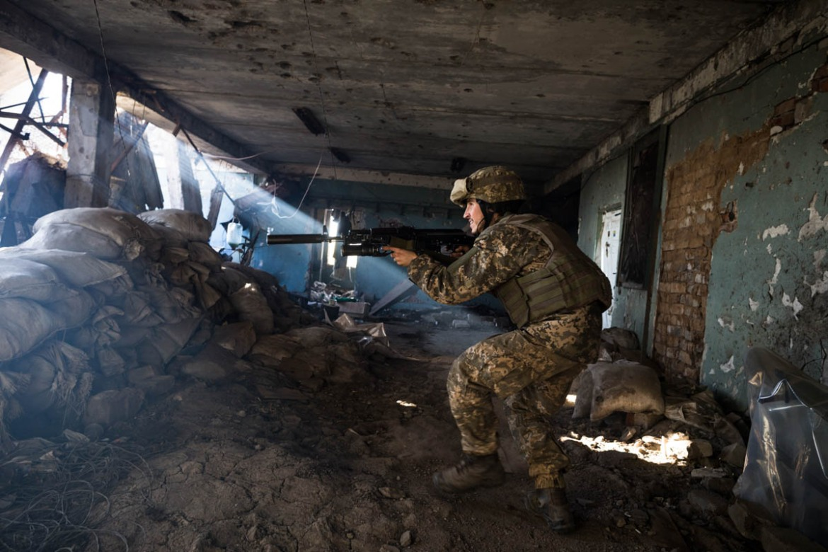 A Ukrainian Army soldier from the 92nd Battalion moves to defend his position among the remains of Shakta Butovka coal mine in Avdiivka, Donetsk region, after some shots fired by separatists. [Erik Messori/CAPTA/Al Jazeera]