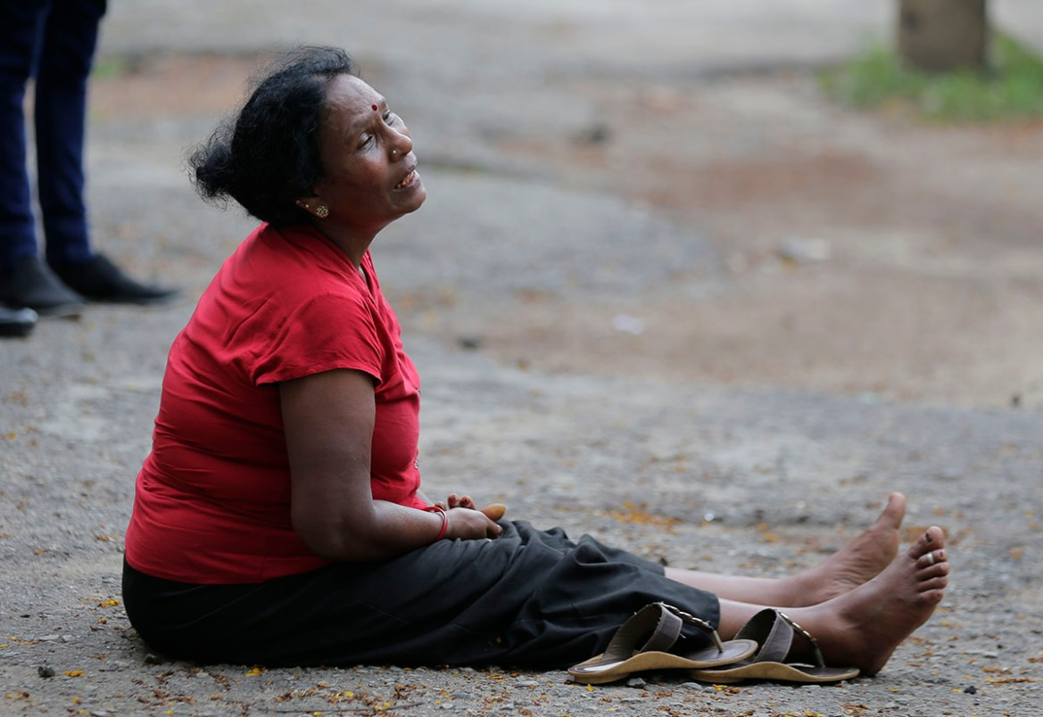 A relative of a blast victim grieves outside a morgue in Colombo. [Eranga Jayawardena/AP Photo]