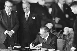 Secretary of State Dean Acheson signs the Atlantic defence treaty for the US, in Washington DC, on April 4, 1949 [File AP Photo]