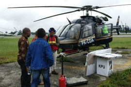 In Papua, in the far east of the Indonesian archipelago, the elections commission uses helicopters to get ballot papers, boxes and other equipment to polling stations. [Daud Mita/Al Jazeera]