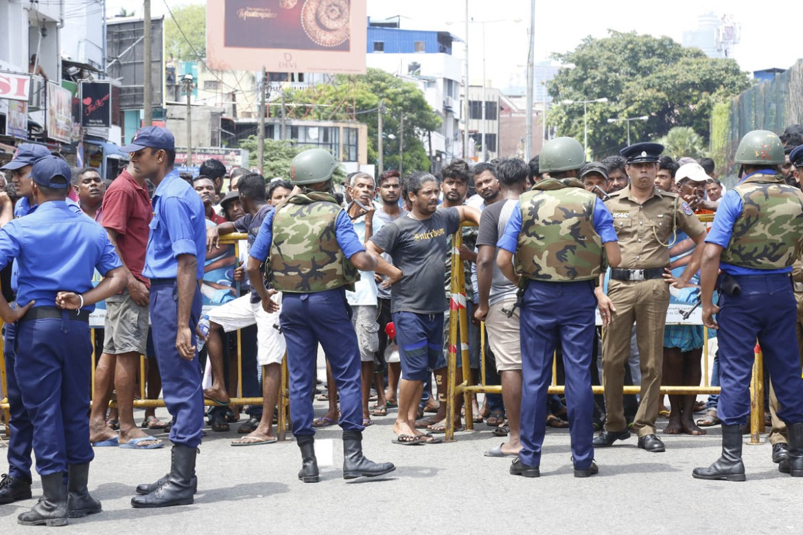 Police cordon off the area after an explosion hit St Anthony's Shrine in Kochchikade in Colombo. [MA Pushpa Kumara/EPA]