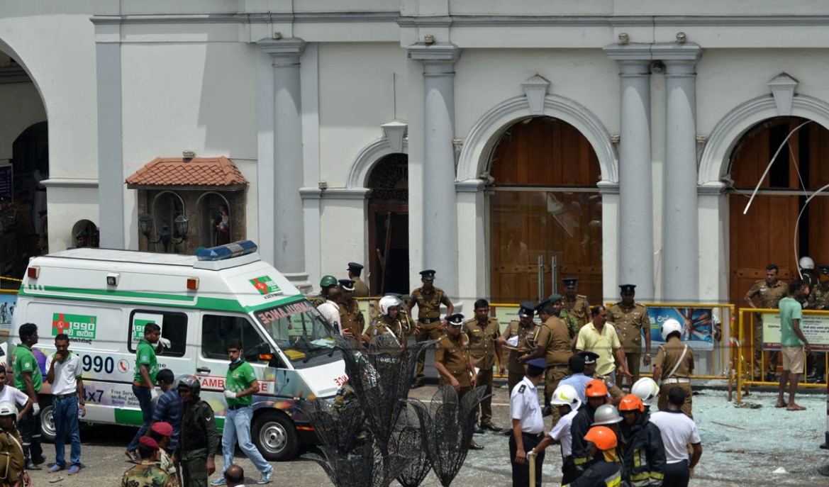 An ambulance and security personnel gather outside St Anthony's Shrine in Kochchikade, Colombo following the blast. [Ishara S. Kodikara/AFP]