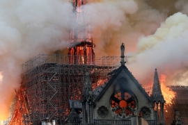 Flames rise from Notre Dame Cathedral as it burns in Paris on Monday [Benoit Tessier/Reuters]