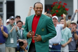 Woods wears the green jacket as he celebrates after winning the 2019 Masters [Brian Snyder/Reuters]