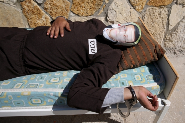 A Palestinian protests the detention of journalist Mohammad al-Qiq, who is on a hunger strike, in the West Bank village of Bilin, near Ramallah on February 19, 2016 [File: Reuters/Mohamad Torokman]