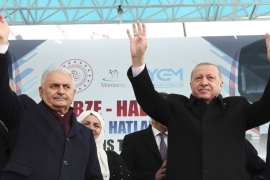 Erdogan, right, and Binali Yildirim, the mayoral candidate of AK Party for Istanbul, salute party supporters before the vote [File: AP]
