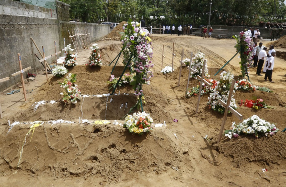 Mass funerals and mass burials were carried out on Tuesday as Sri Lanka continued to mourn. [M A Pushpa Kumara/EPA]
