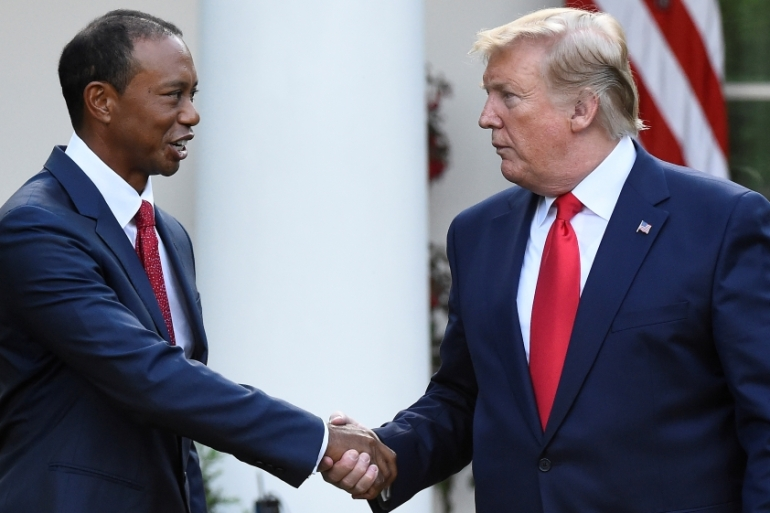 Trump, an avid golfer, and Woods have played together in the past [Clodagh Kilcoyne/Reuters]