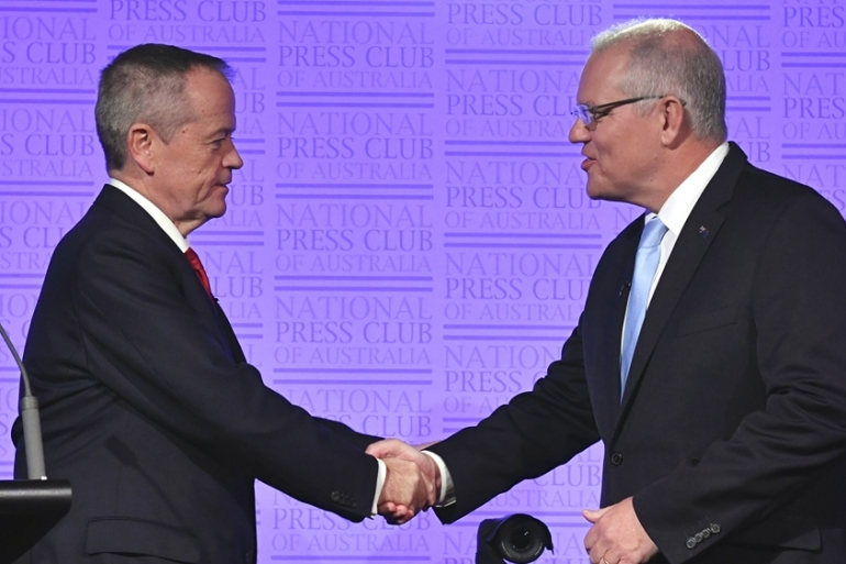 Australian Prime Minister Scott Morrison, right, and opposition leader Bill Shorten shake hands before the third leaders debate on May 8 [Mick Tsikas/AAP Image via AP Photo]