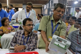 Election officials count votes at a counting centre in Mumbai [Francis Mascarenhas/Reuters]
