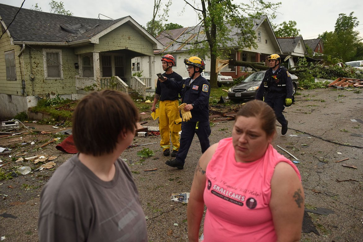 Safety crews check for damage and injuries in city neighbourhoods. The tornado was rated as an EF-3, with winds of over 250km/h. [Antranik Tavitian/Reuters]