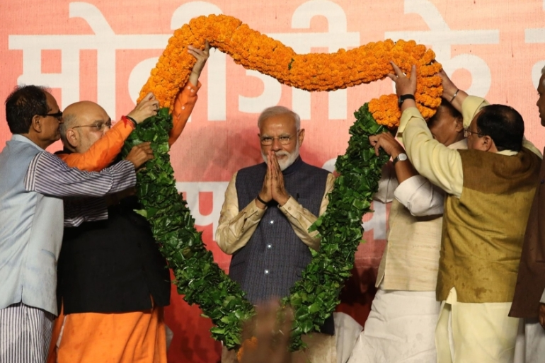 Prime Minister Naredndra Modi along with BJP president Amit Shah during victory celebrations at the BJP headquarters in New Delhi, India, on Thursday, 23MAY, 2019. [T. Narayan/Bloomberg]