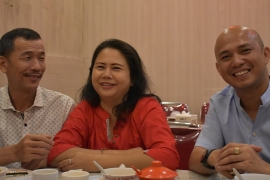 Meliana enjoys dinner at a local dim sum restaurant with her husband (L) and lawyer (R) after being freed from prison [Aisyah Llewellyn/Al Jazeera]