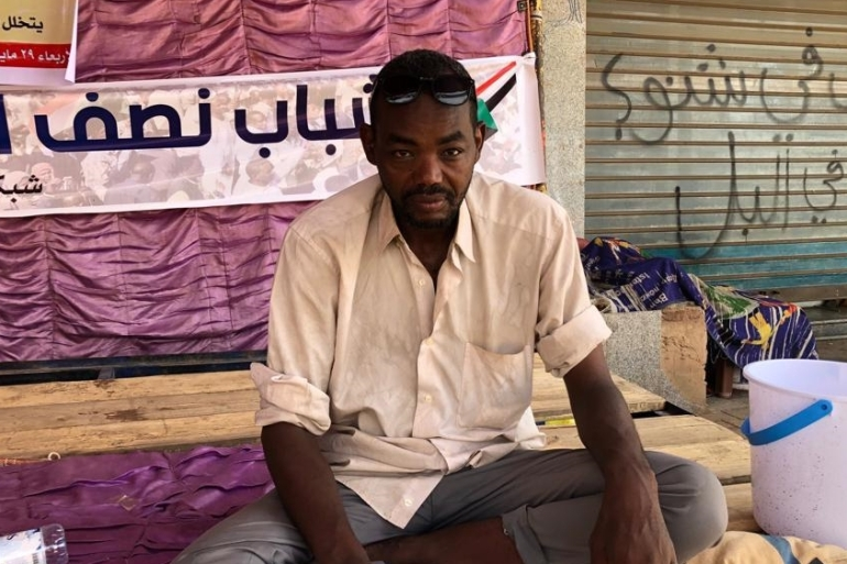 Demonstrator Eismat Ali says he comes to the demonstration every week, when he is off work, that protesting 'should be our real job' [Zeinab Mohammed Salih/Al Jazeera]