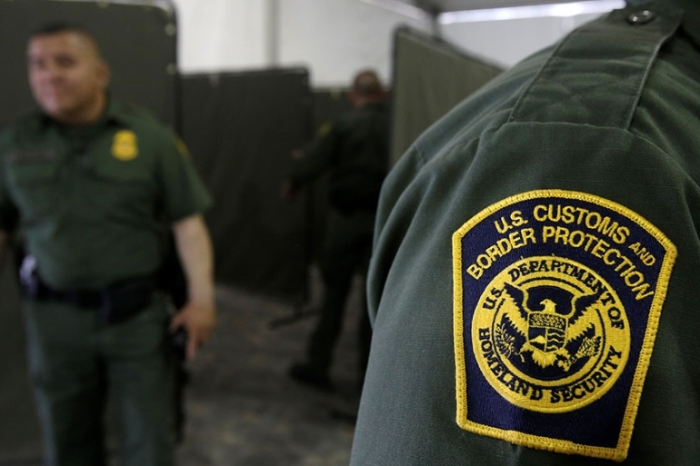 US Border Patrol agents are seen during a tour of US Customs and Border Protection temporary holding facilities in El Paso, Texas [Jose Luis Gonzalez/Reuters]