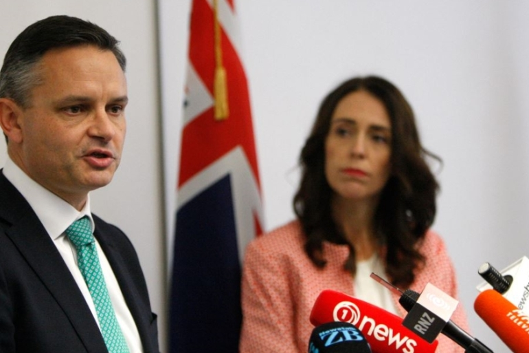 Climate Change Minister James Shaw, (left), and PM Jacinda Ardern talk to reporters in Wellington [Nick Perry/AP Photo]