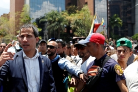 Venezuelan opposition leader Juan Guaido has called for massive protests [Carlos Garcia Rawlins/Reuters]
