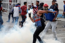 Maduro: 'Coup attempt' defeated as police clash with protesters
