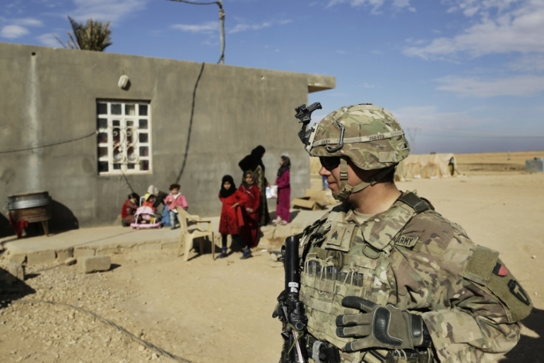 US soldiers on a reconnaissance patrol near a coalition outpost in Iraq's Anbar province [File: Susannah George/AP]