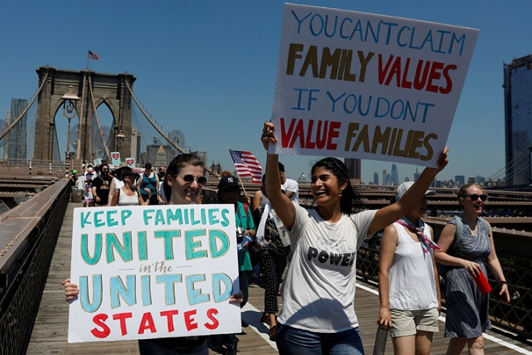 Demonstrators march on Brooklyn Bridge during 'Keep Families Together' march to protest Trump administration's immigration policy in New York [File: Shannon Stapleton/Reuters]