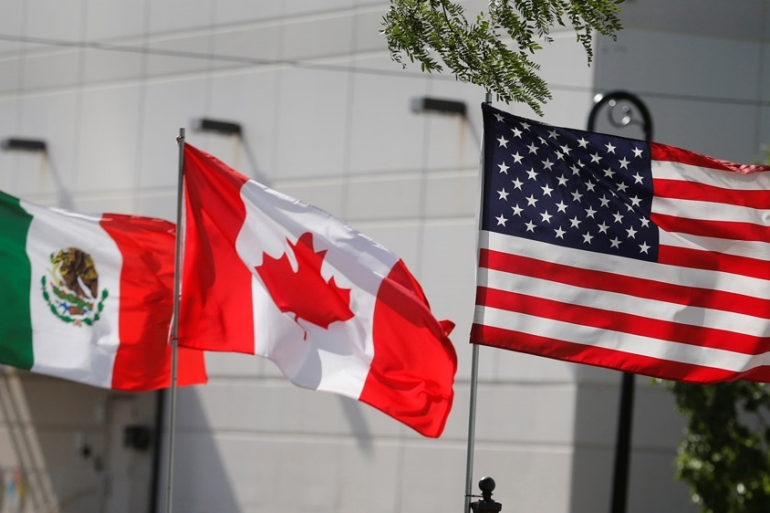 A new agreement between the United States, Canada and Mexico removes a major hurdle to the passage of a new pact to replace the North American Free Trade Agreement (NAFTA). [File: Rebecca Cook/Reuters]