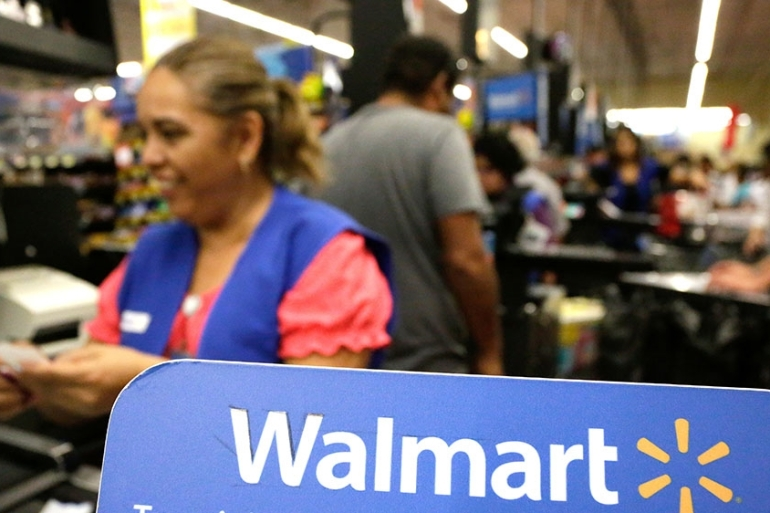 A key driver of Walmart's growth was the company's web division. Consumers are buying more groceries online, and Walmart's US online sales jumped 37 percent. [Daniel Becerril/Reuters]