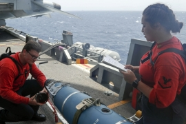 US sailors inspect a bomb on the USS Abraham Lincoln sailing near the Gulf [Michael Singley/US Navy/AP]