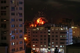A ball of fire is seen during an Israeli air raid in Gaza City. [Suhaib Salem/Reuters]