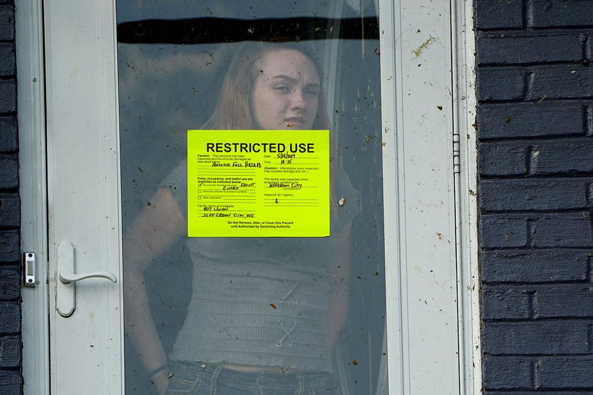 Restricted Use stickers mark areas of buildings or whole structures that are a hazard and need to be repaired or should be avoided. [Carlo Allegri/Reuters]