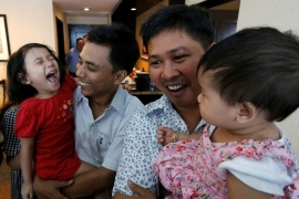 Wa Lone and Kyaw Soe Oo celebrated with their children after being freed [Ann Wang/Reuters]