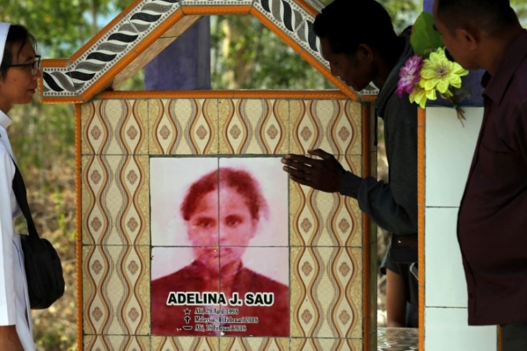 The tombstone of Adelina Sau in Abi village in West Timor, Indonesia [File: Tatan Syuflana/AP Photo]