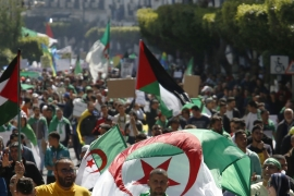 Algerian demonstrators march during a protest in Algiers on March 29, 2019 [File: Toufik Doudou/AP]