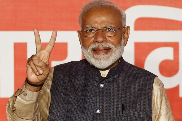 Indian Prime Minister Narendra Modi gestures towards his supporters after the election results were announced at the BJP headquarters in New Delhi on May 23, 2019 [Reuters/Adnan Abidi]