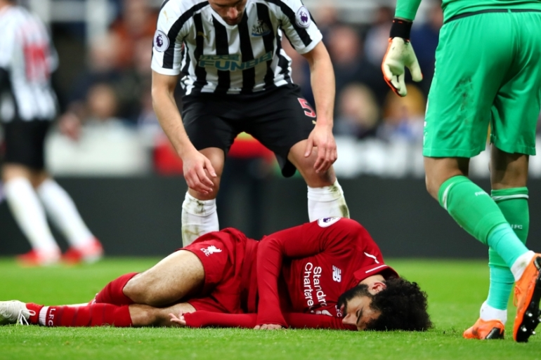 Salah was carried off the pitch with a head injury in Liverpool's Premier League win against Newcastle United on Saturday [Clive Brunskill/Getty Images]