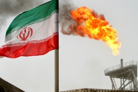 A gas flare on an oil production platform in the Soroush oil fields is seen alongside an Iranian flag in the Gulf [File: Raheb Homavandi/Reuters]