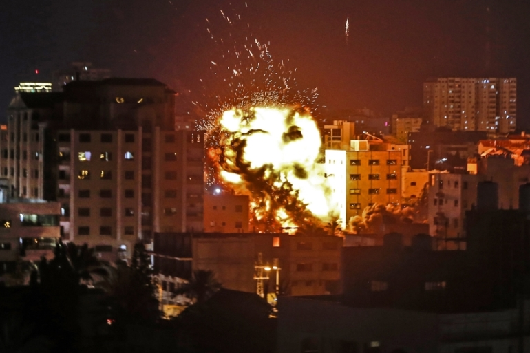 An explosion is pictured among buildings during an Israeli air raid on Gaza City on May 4 [Mahmud Hams/AFP]
